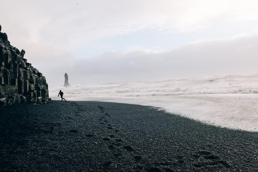 Black Sand Sline Under Cloudy Sky