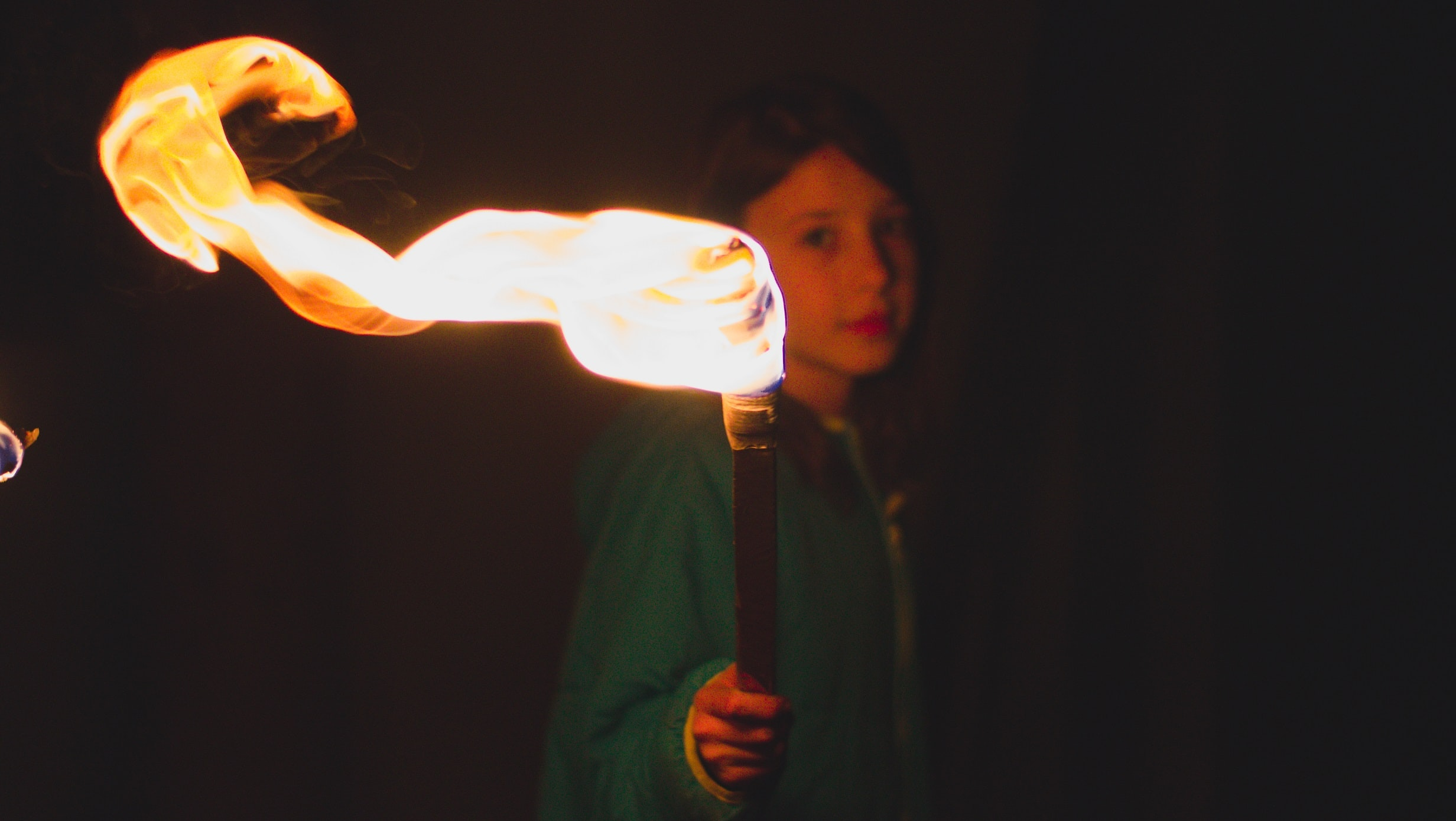 person holding torch during night time
