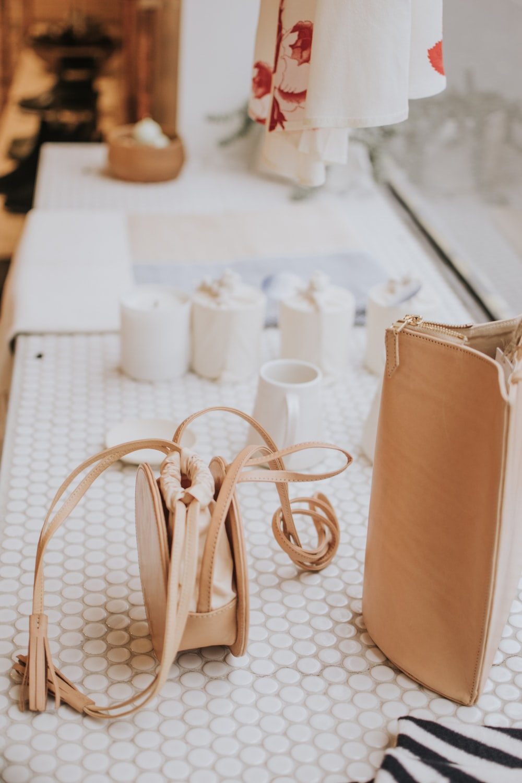 women's beige leather sling bag