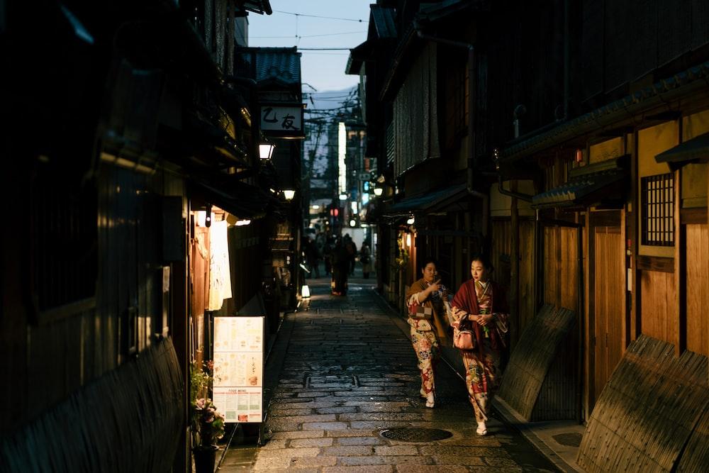 women walking on street