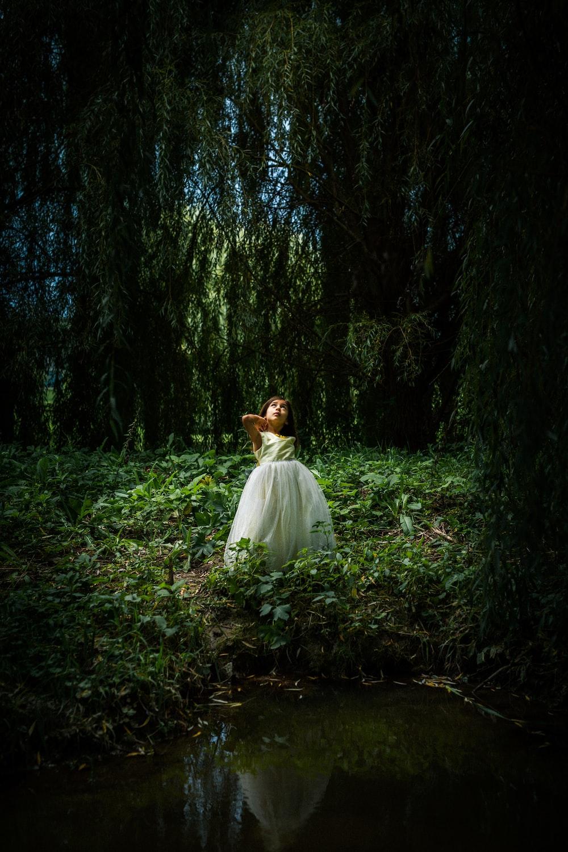 woman on woods wearing white dress