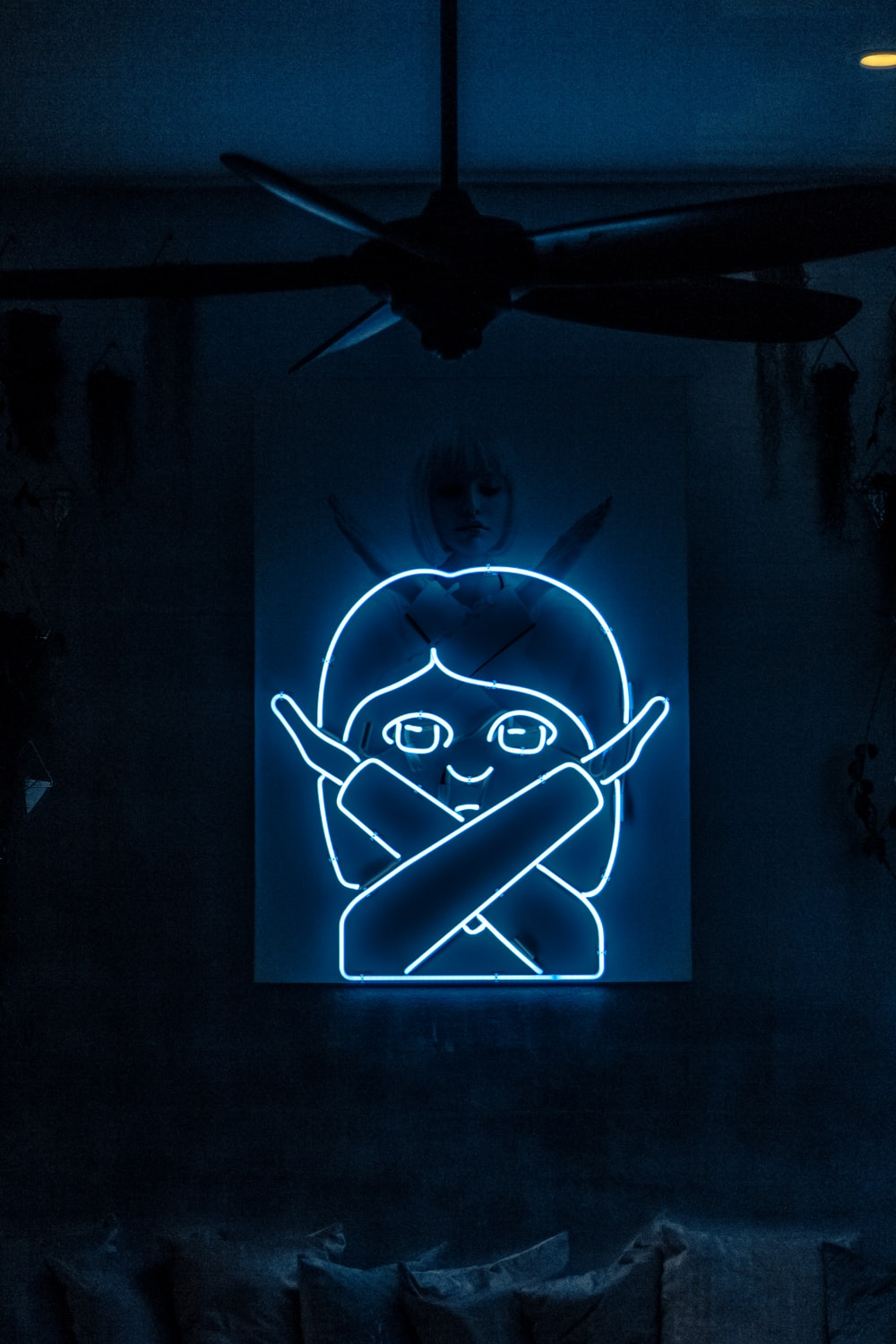 neon signage of woman crossing her both arms