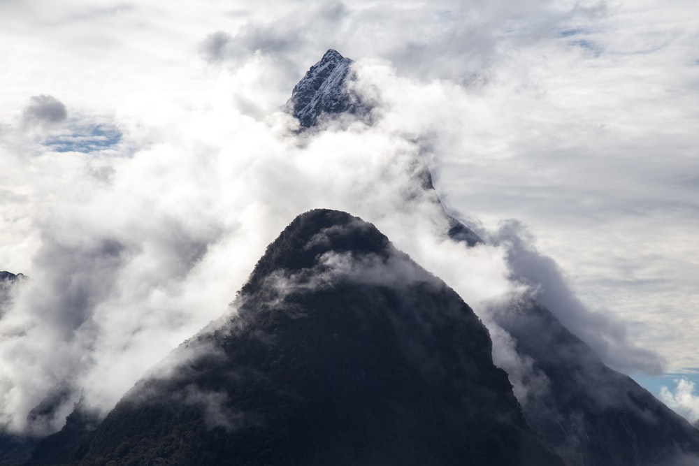 aerial photography of mountain covered with fogs