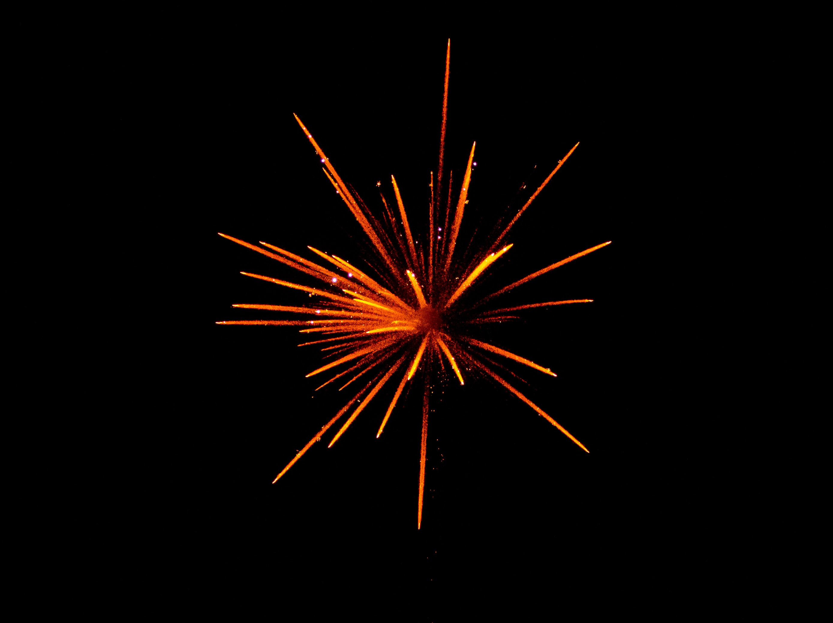 red and orange fireworks in black background