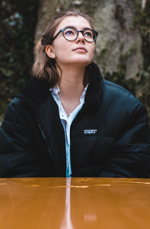 woman wearing black jacket looking up
