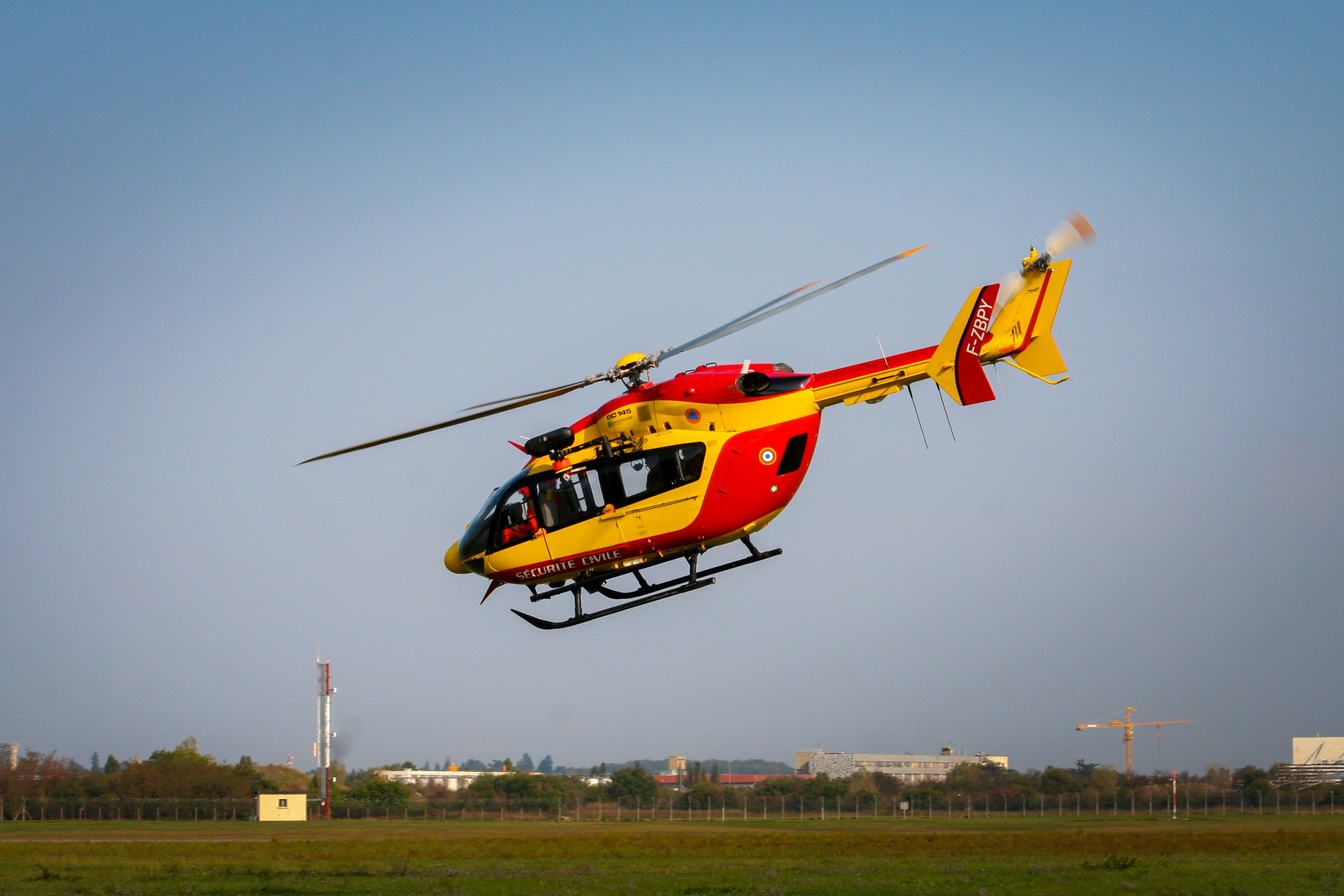 yellow and red helicopter on the sky