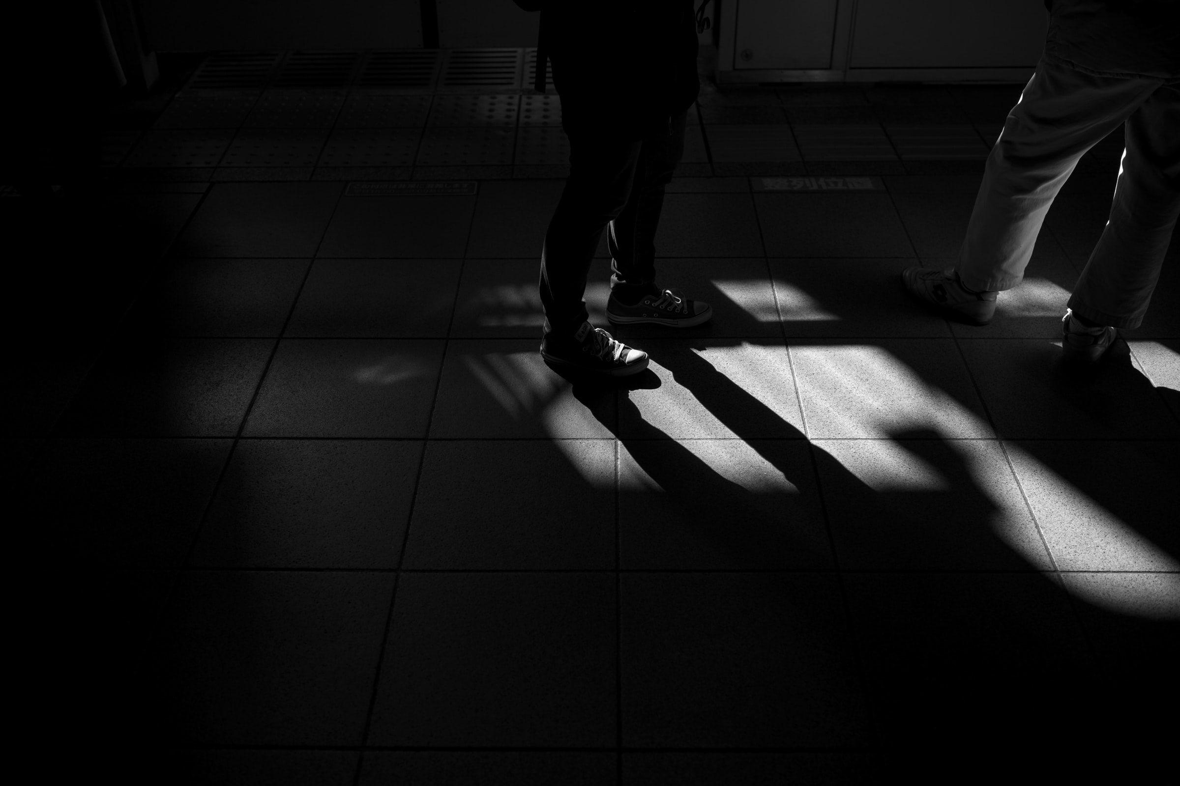 two person standing on white tile