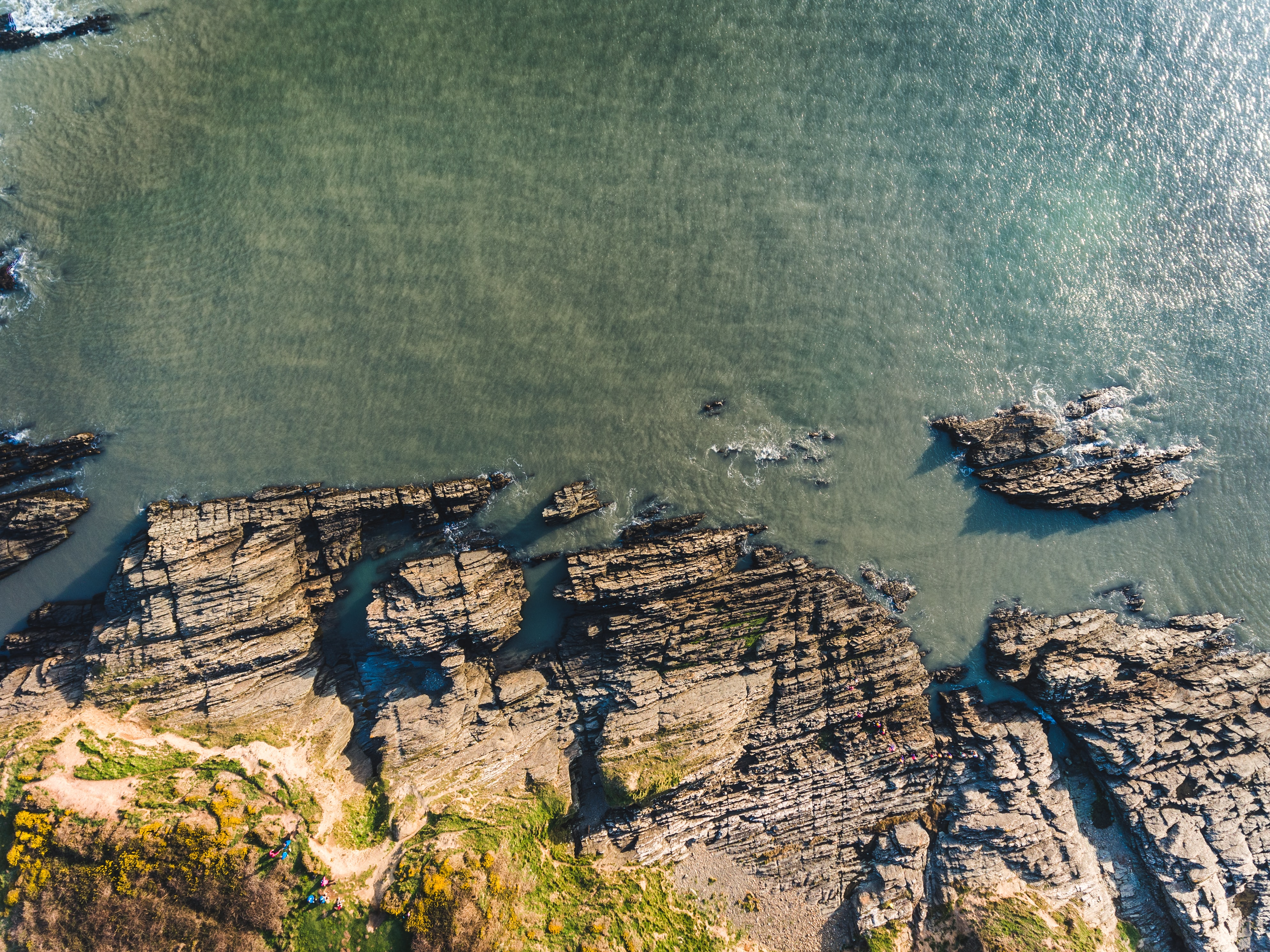 aerial photography of rocky shore during daytime
