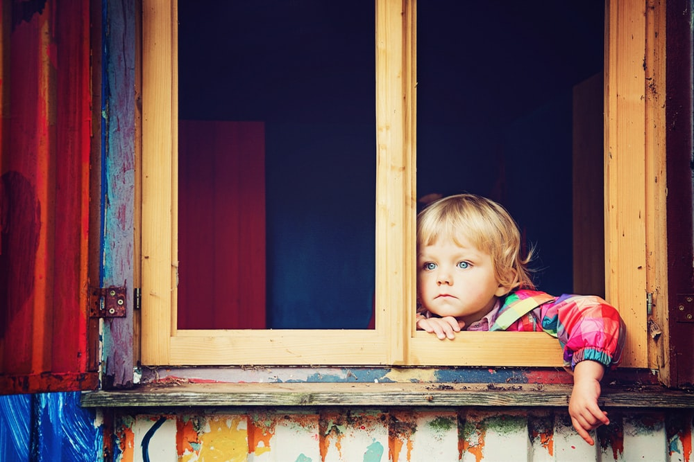 toddler looking at window