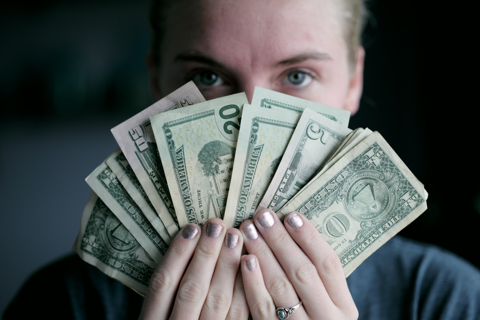 Young woman holding money.
