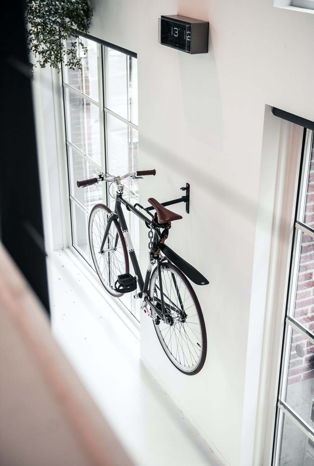 black mountain bicycle mounted on wall