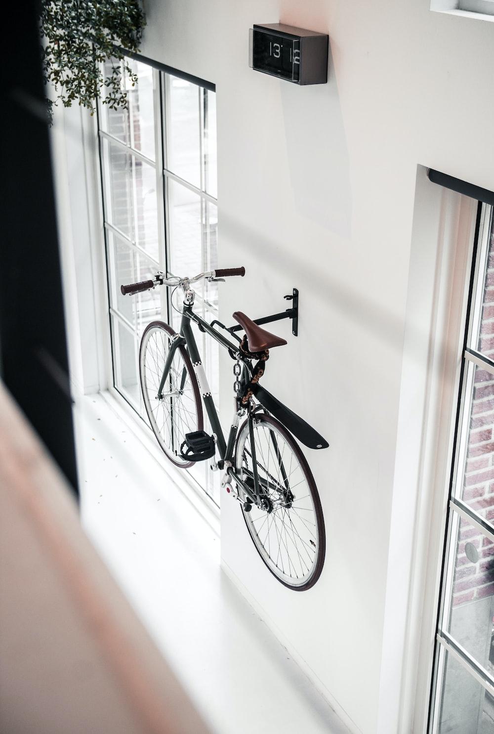black mountain bicycle mounted on wall