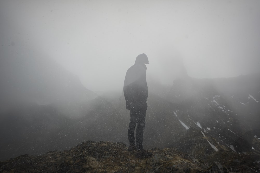 man standing on ground clip mountain