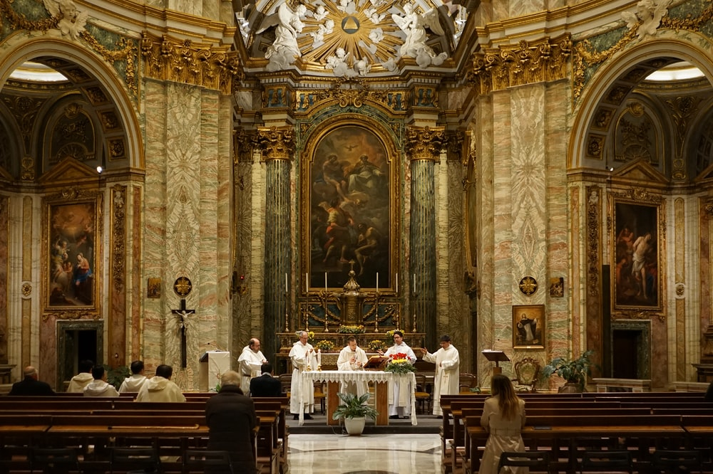five priest inside cathedral