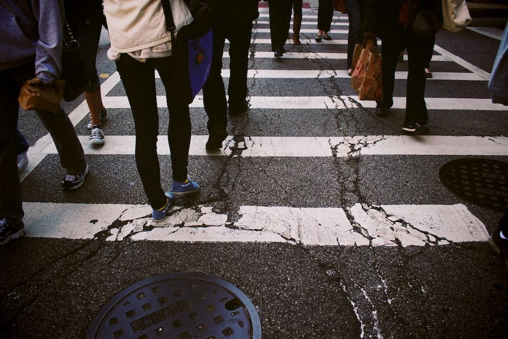 group of person walking on pedestrian lane