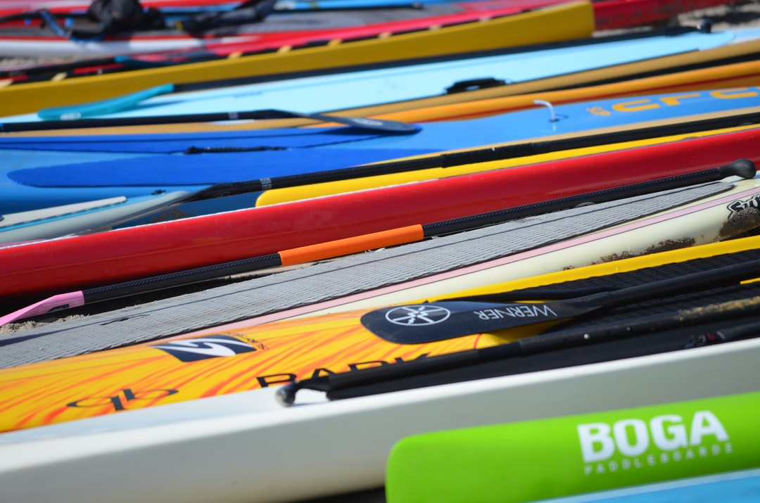 Long boards side by side in a colorful row