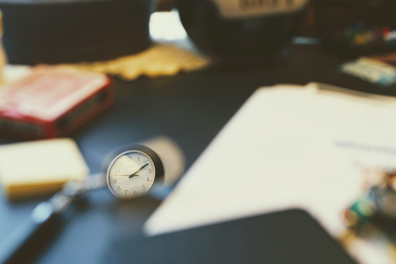 round black and white analog wall clock