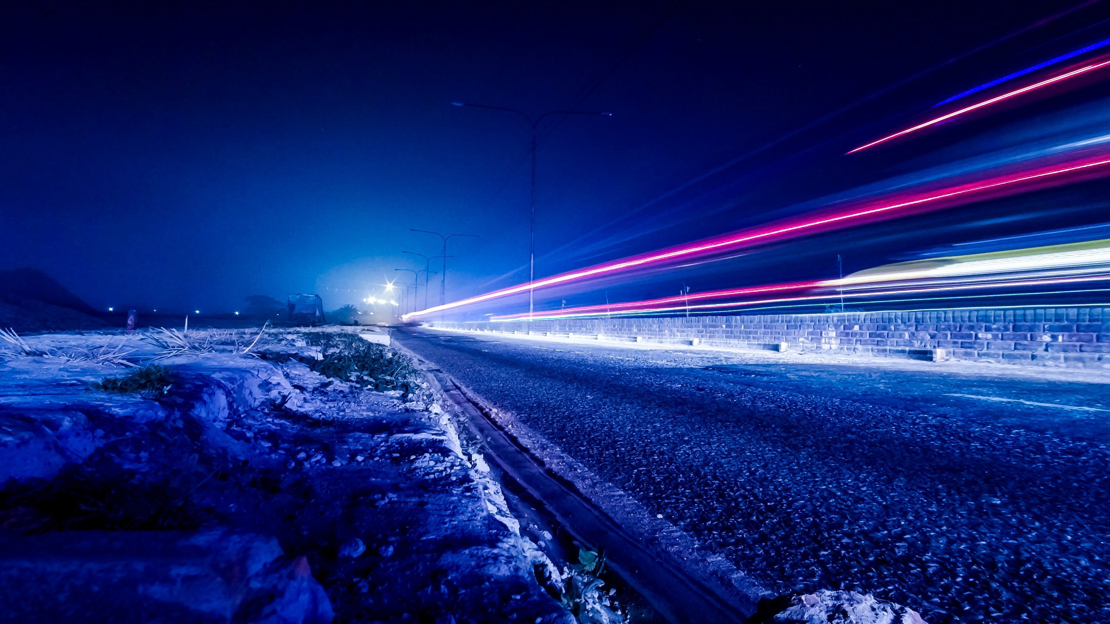 time lapse photography of vehicle light during nighttime