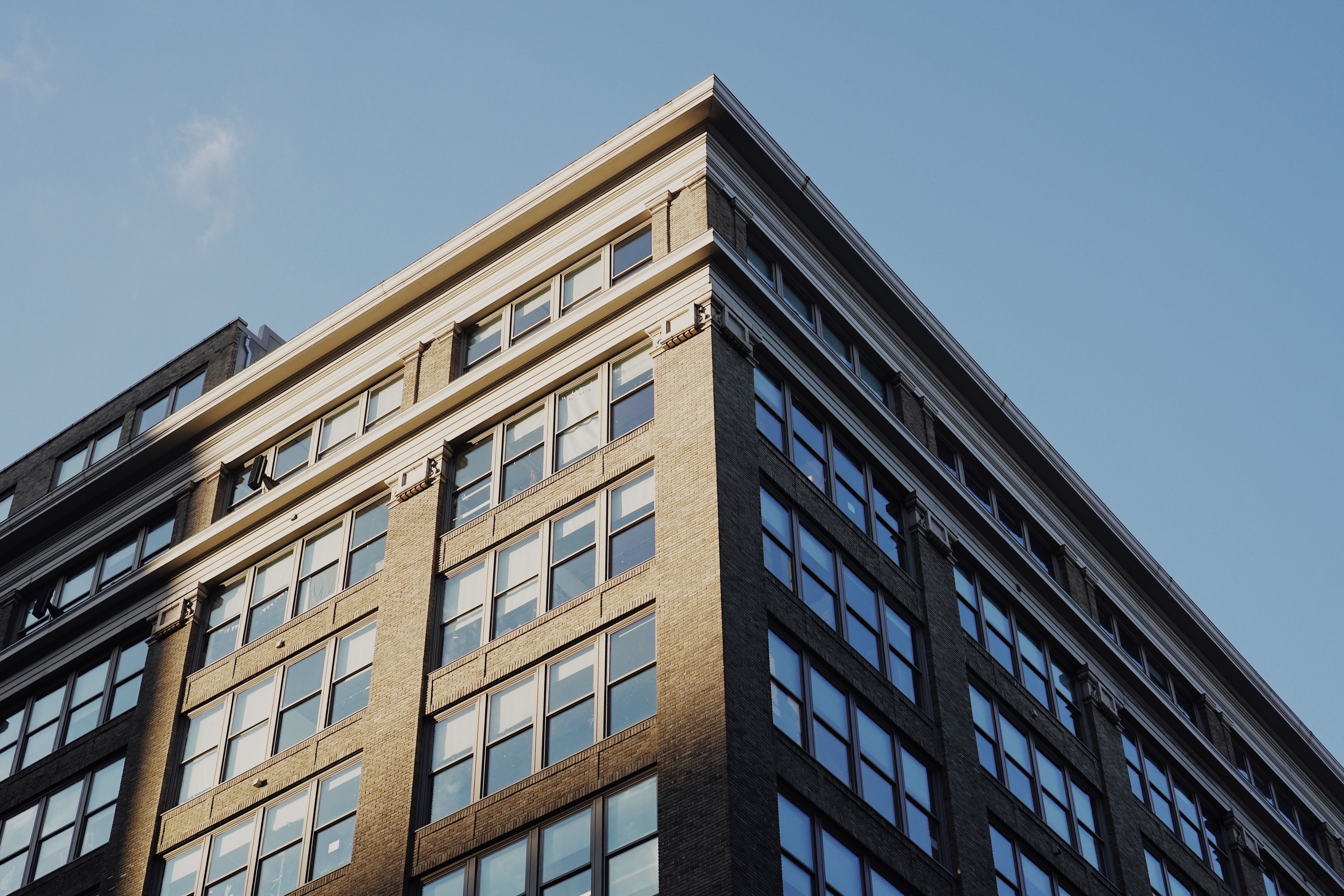 low angle photo of gray concrete building