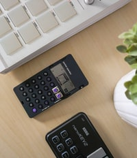 black digital device on table