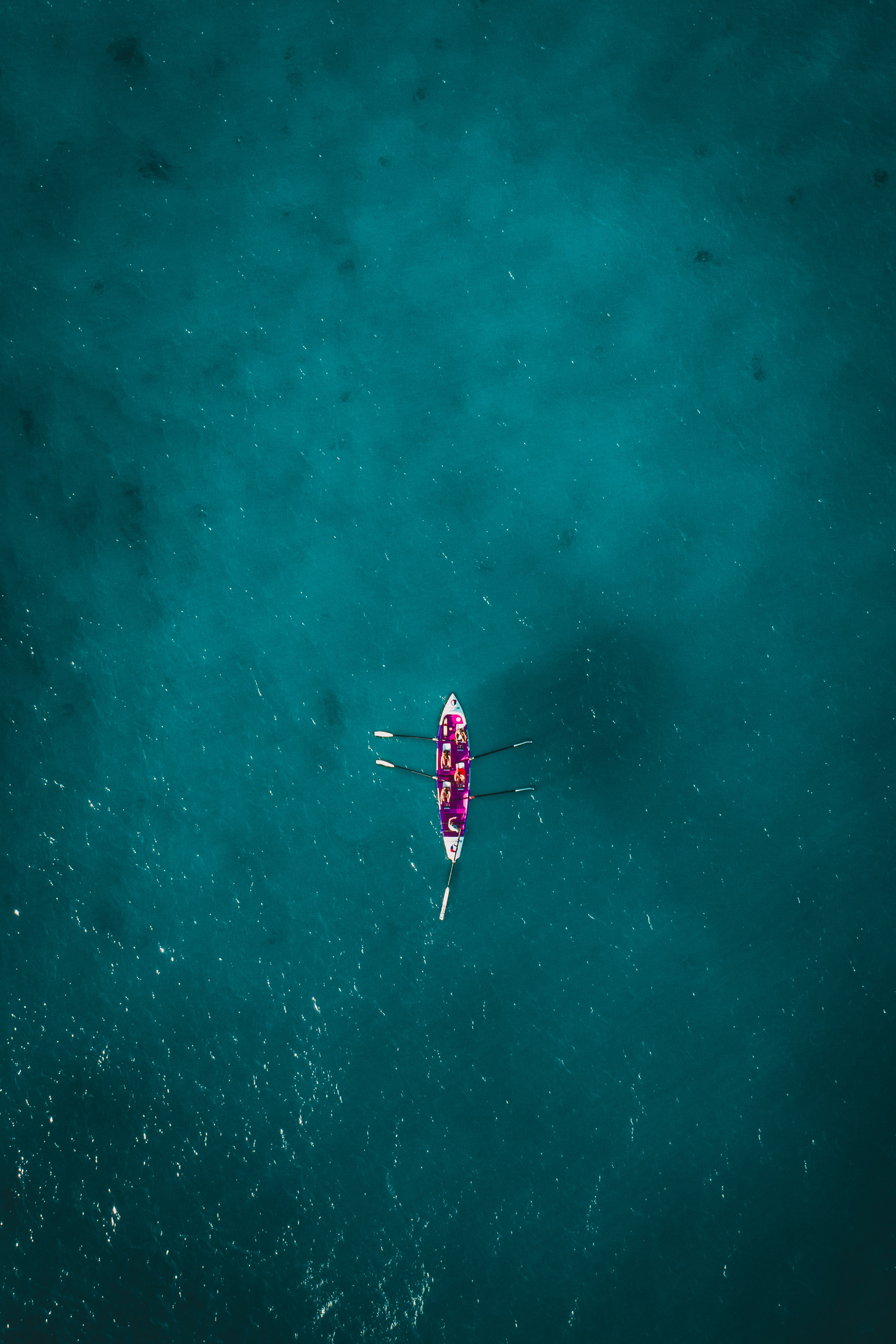 top-view photography of two persons kayaking on water
