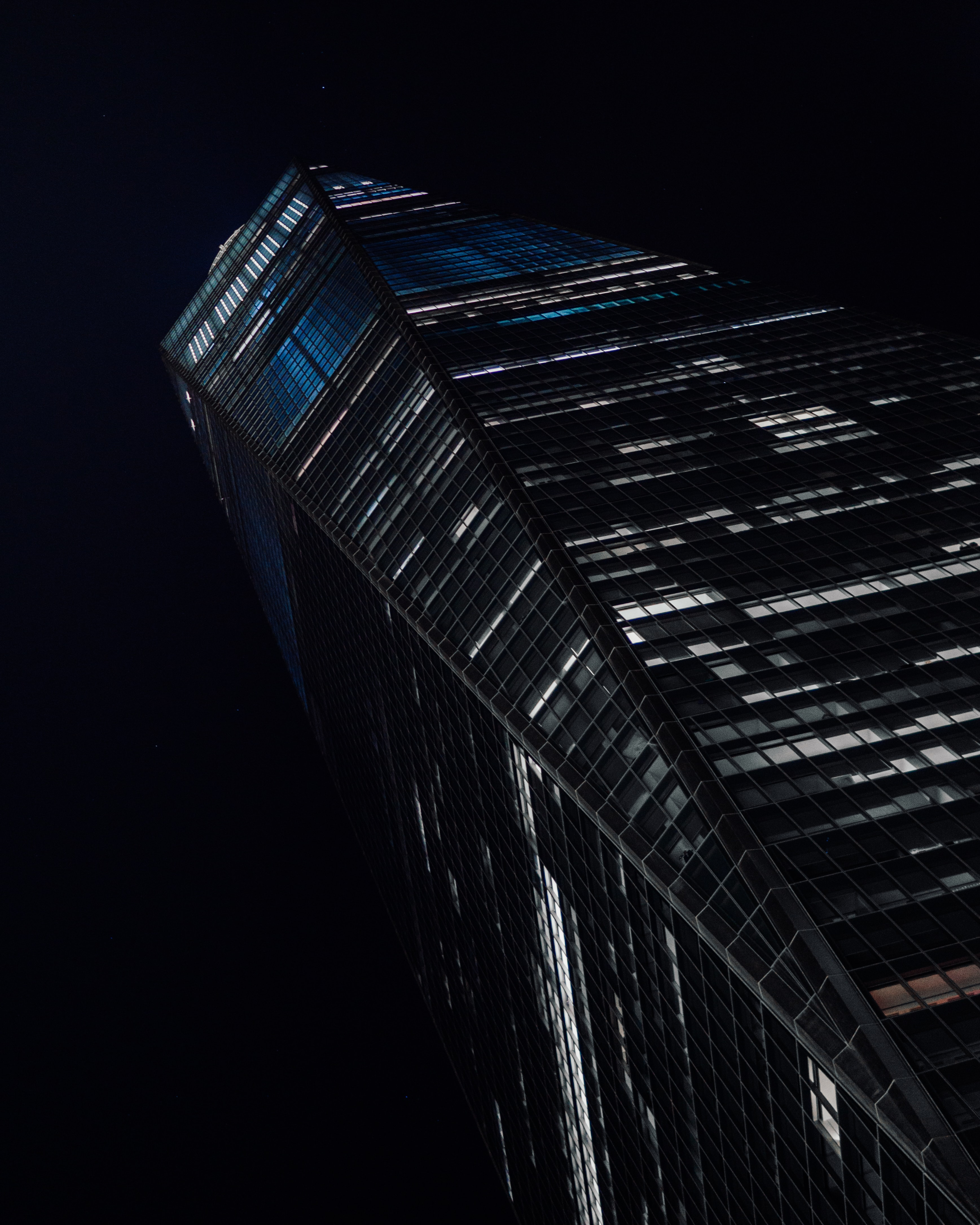 low-angle photography of high-rise building at nighttime