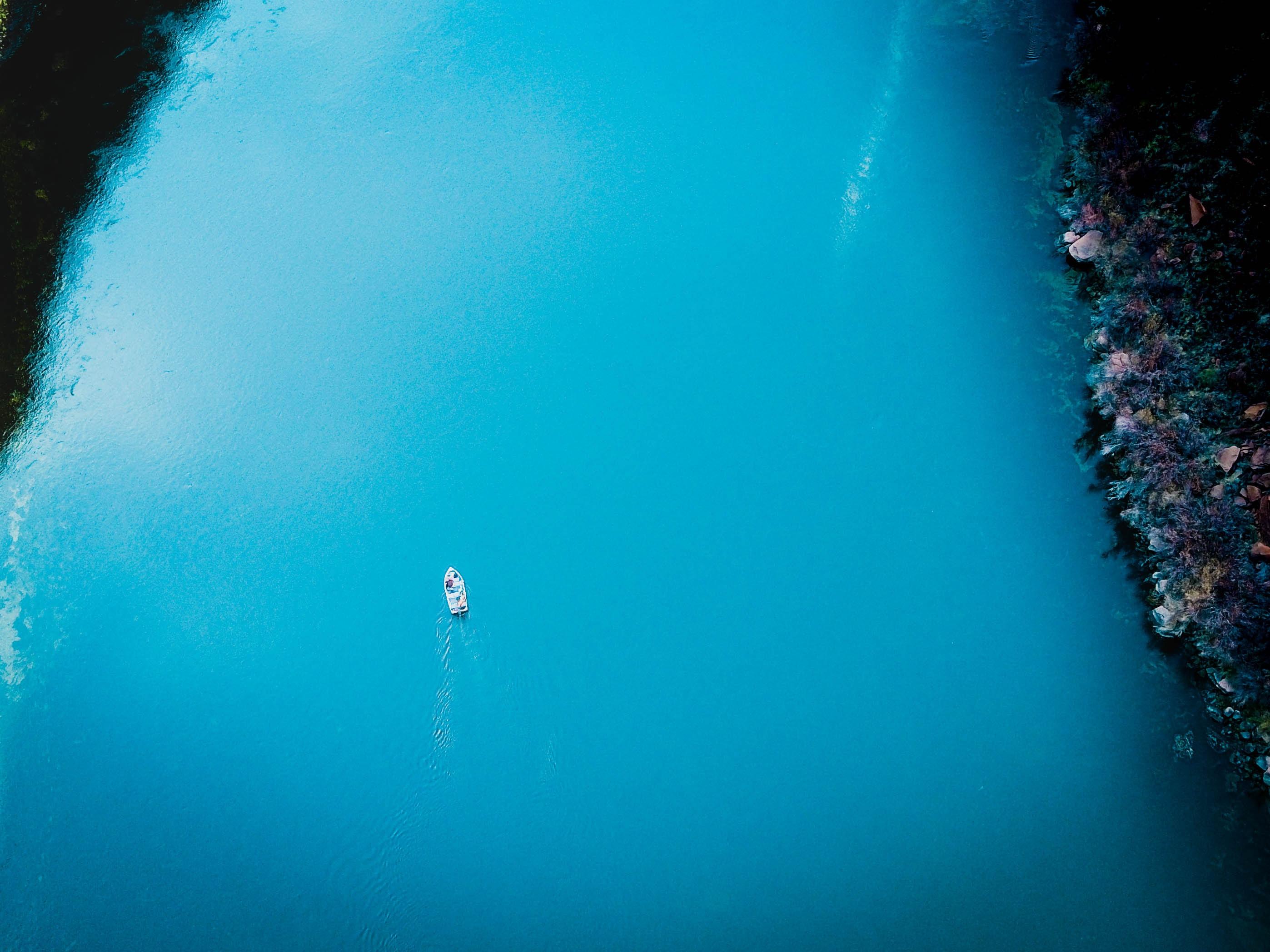 aerial photo of boat sailing on sea