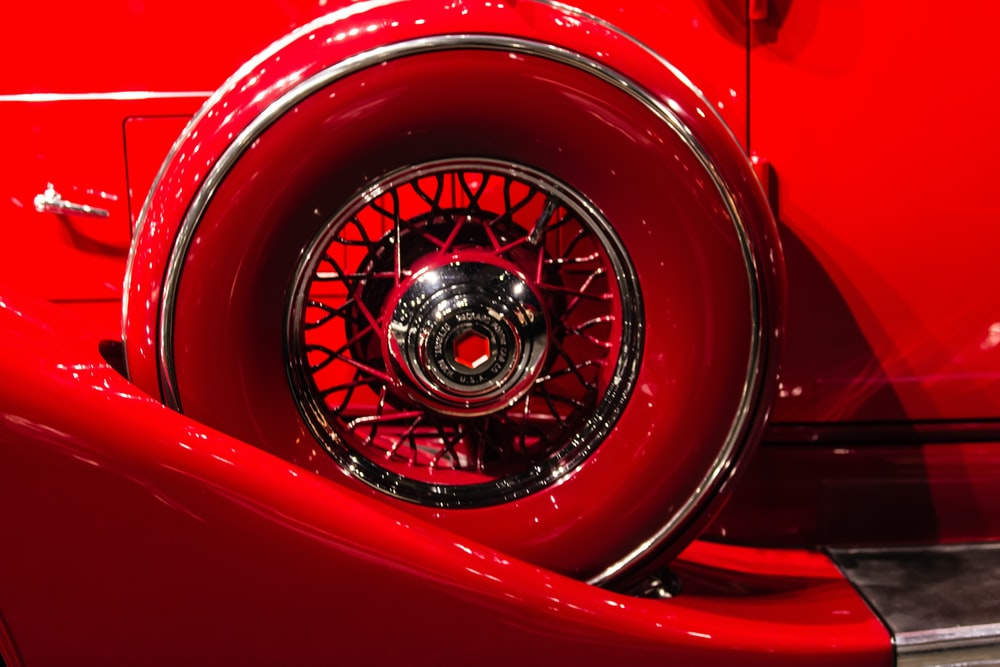 photo of a red vehicle wheel and tire set