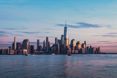buildings near body of water landscape photography new york city zoom background