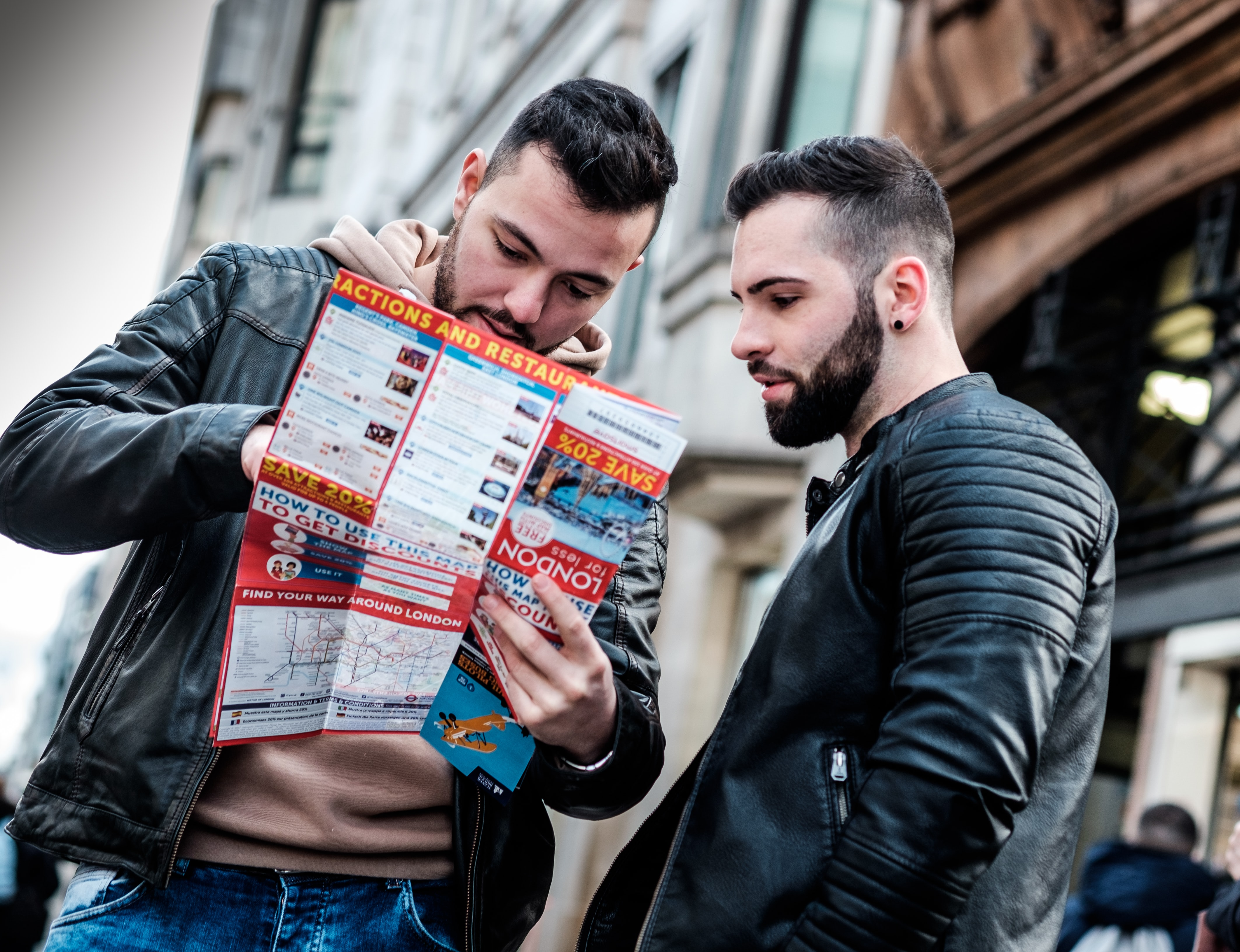 two men reading brochure