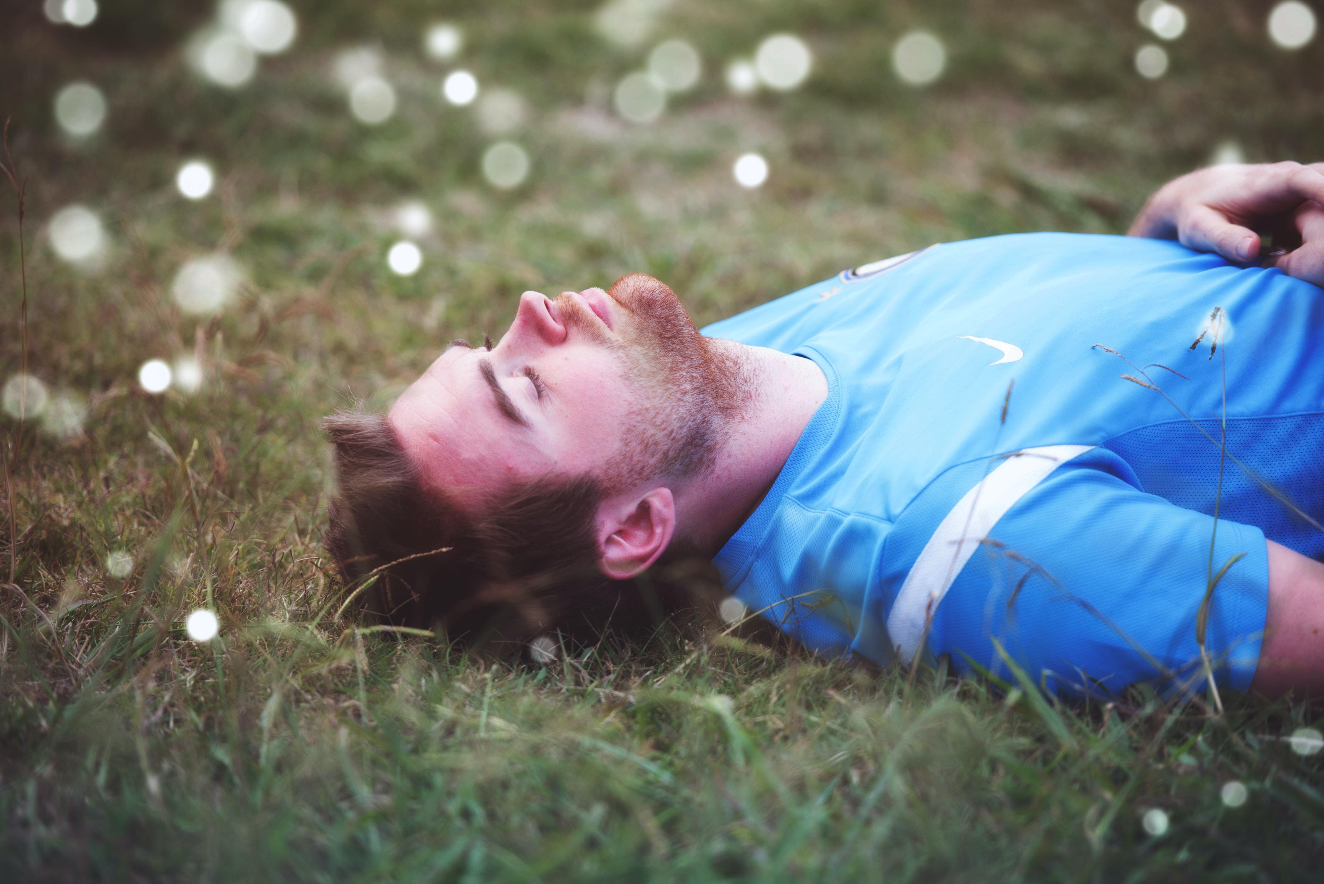 man lying down on grass