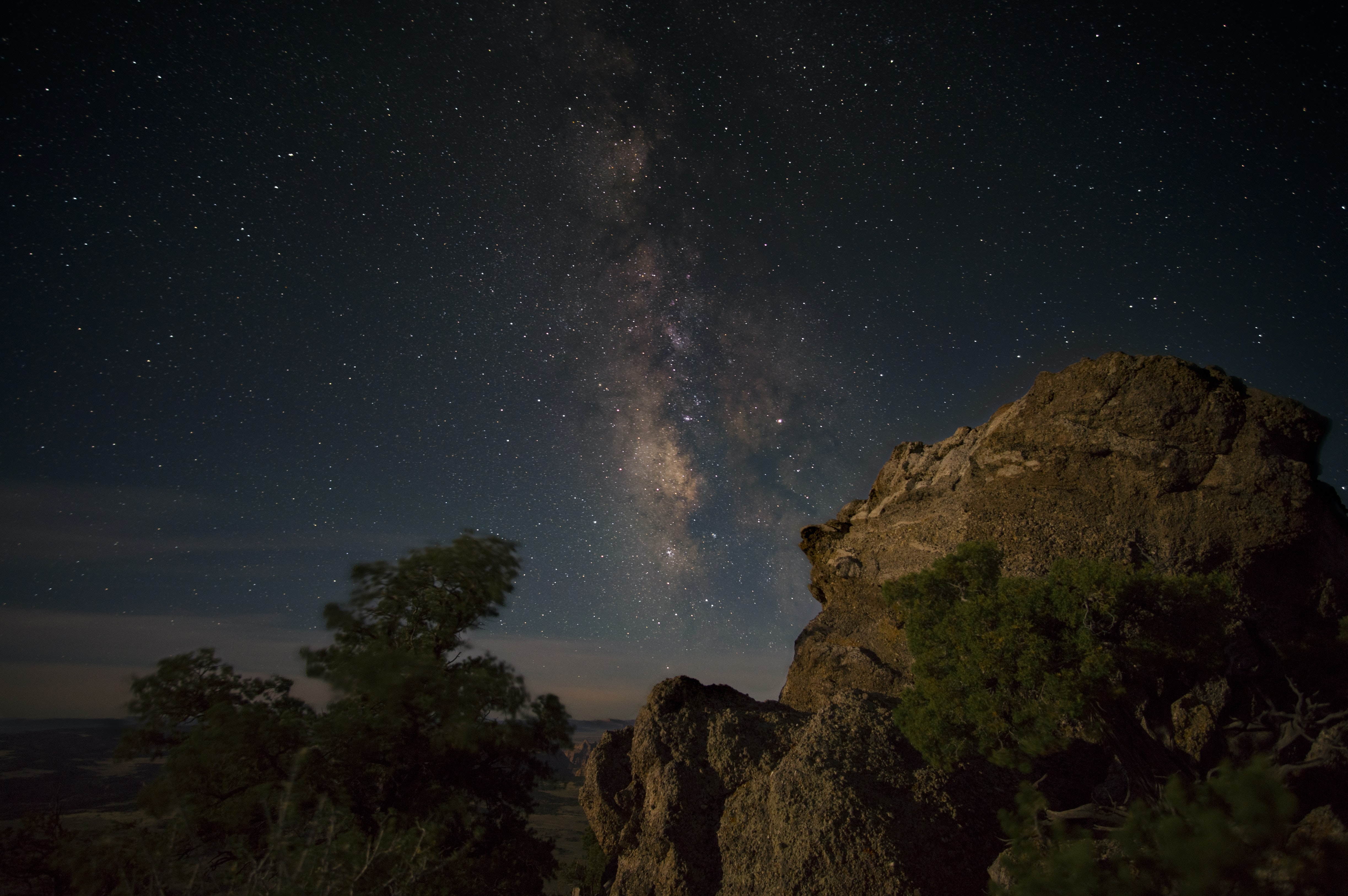 rock formation mountain under sky with stars