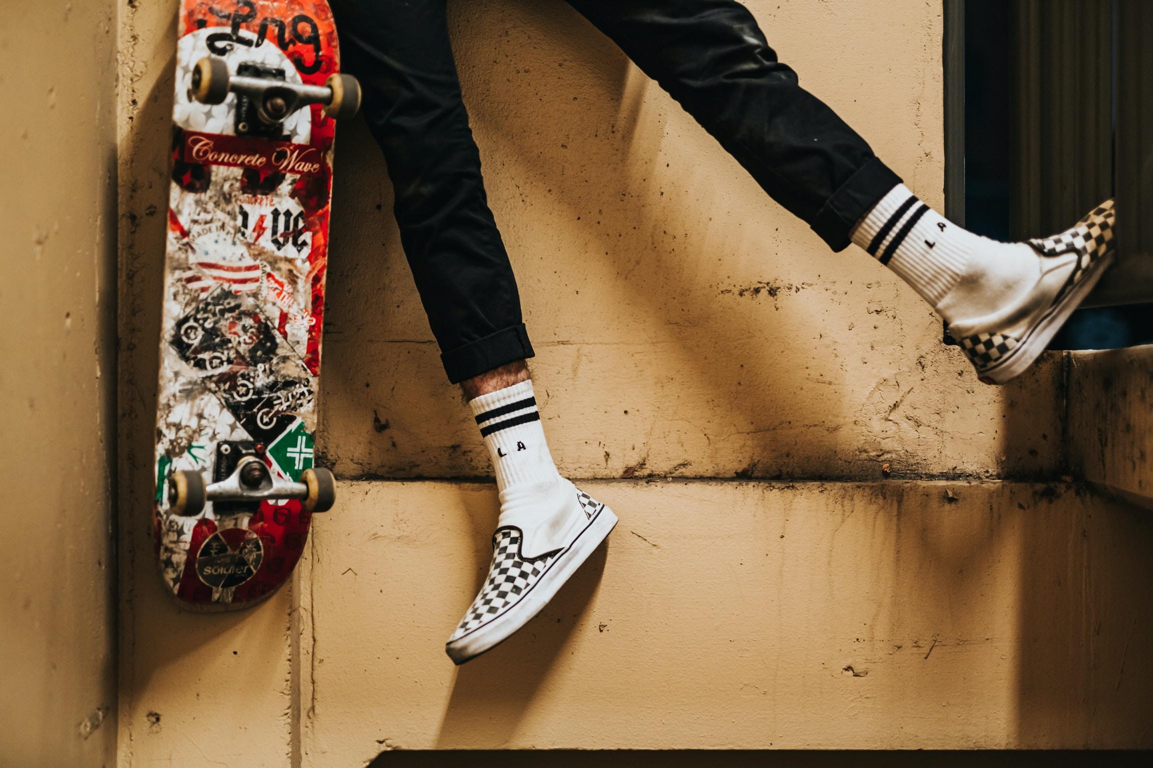 person beside skateboard