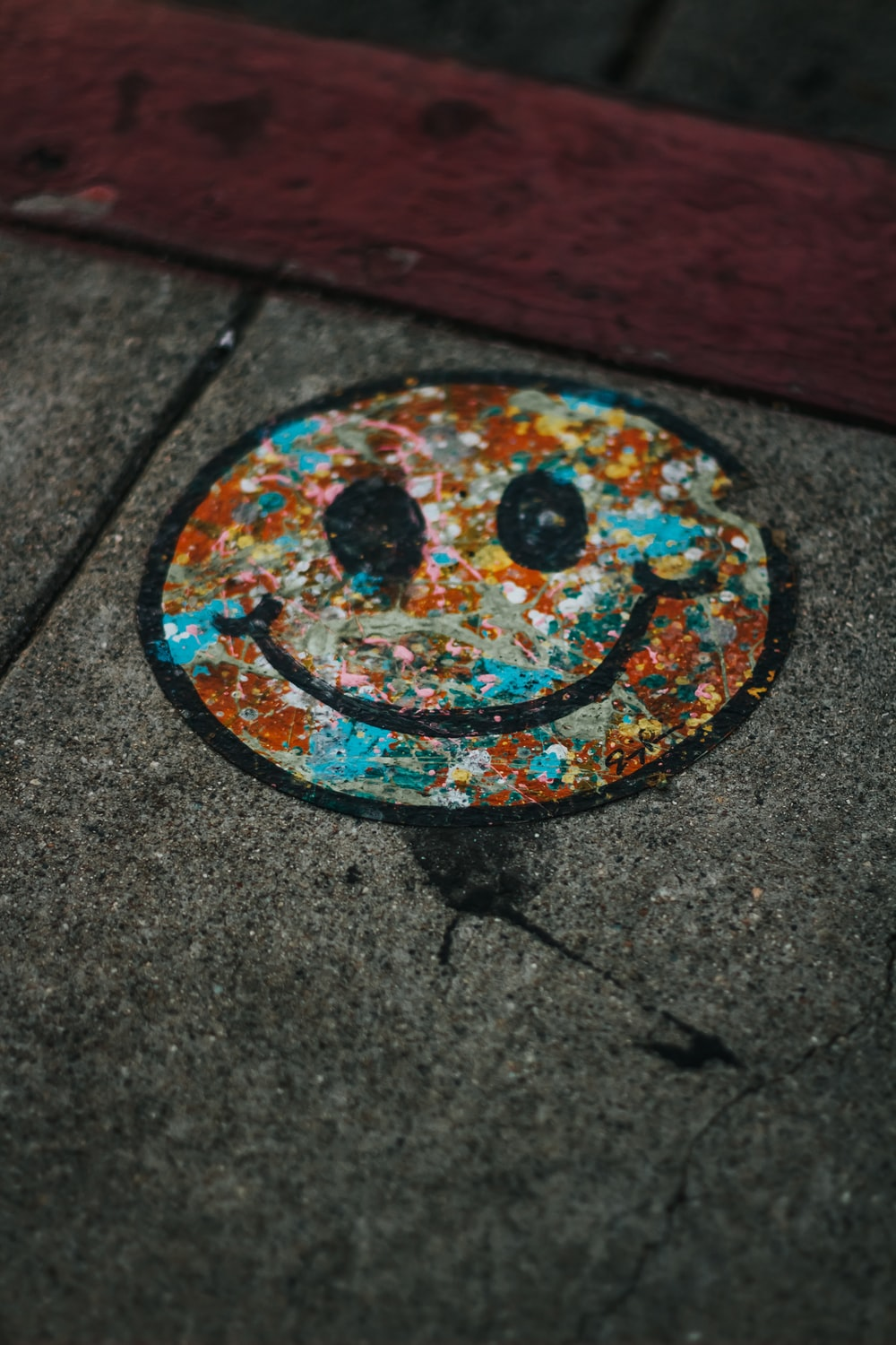 round brown and teal smiley print