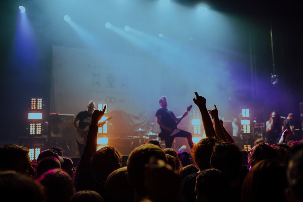 group of band on stage with LED lights