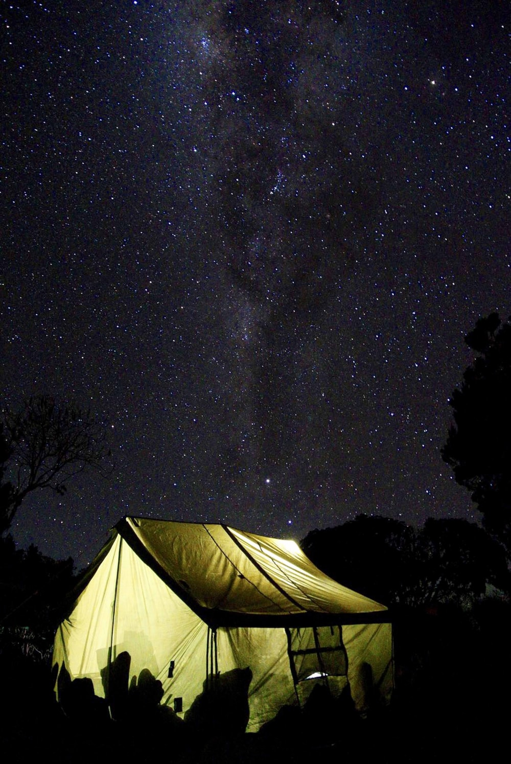 milky way galaxy under yellow camping tent