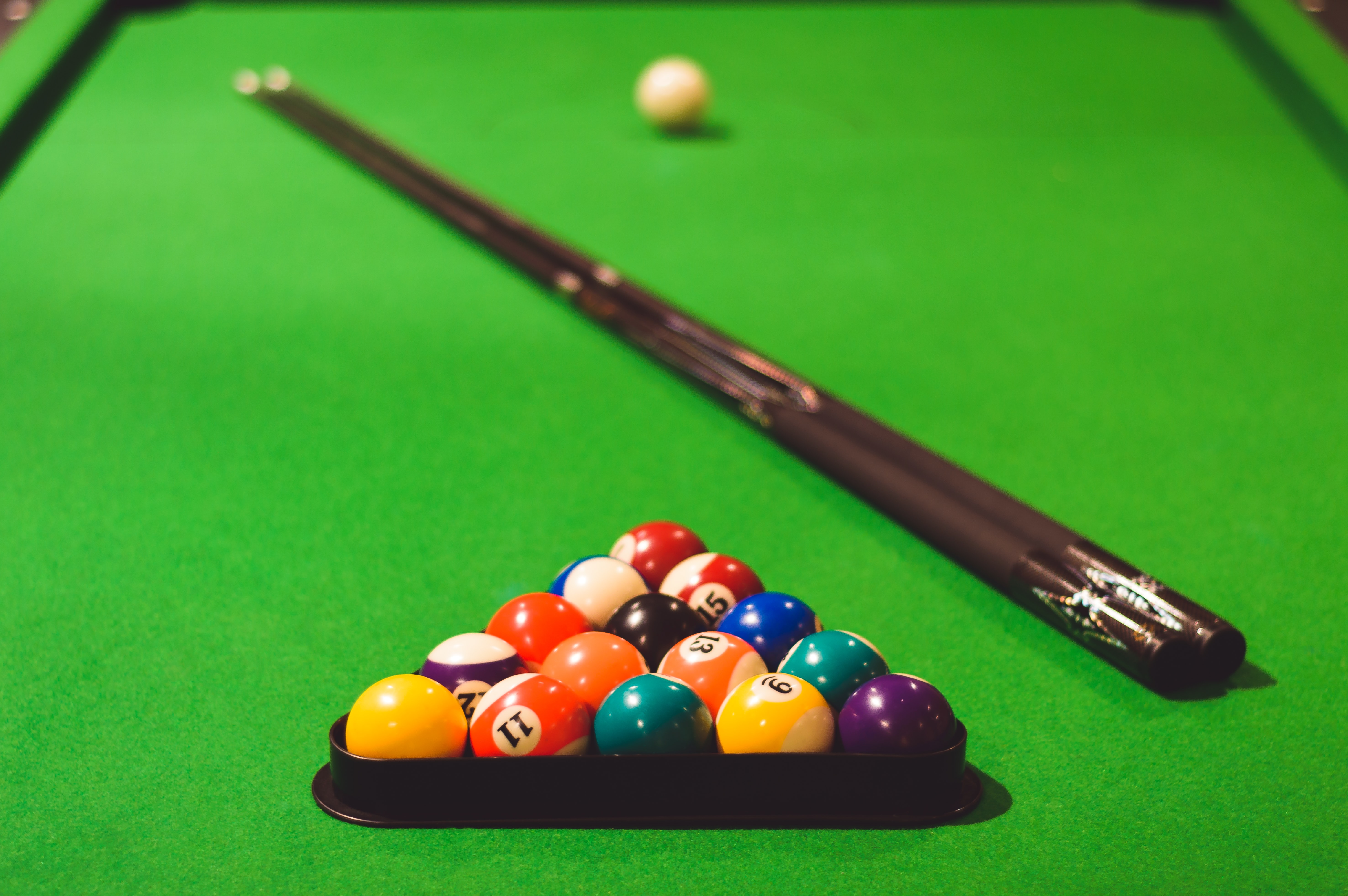 shallow focus photo of billiard cue ball set