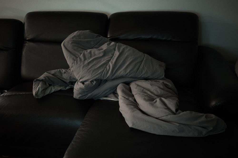 gray fabric cover on sofa