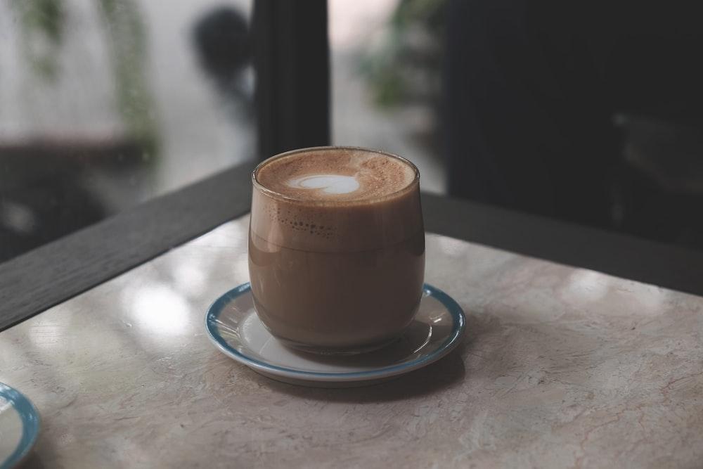 coffee glass on white saucer