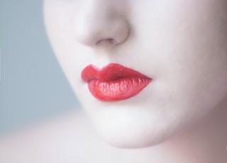 woman with orange lipsticks