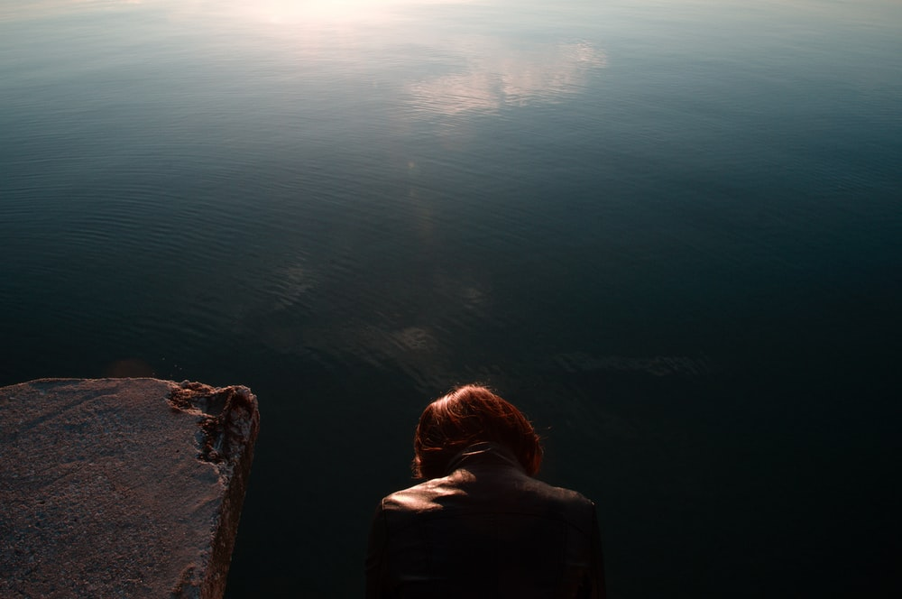 person looking on body of water