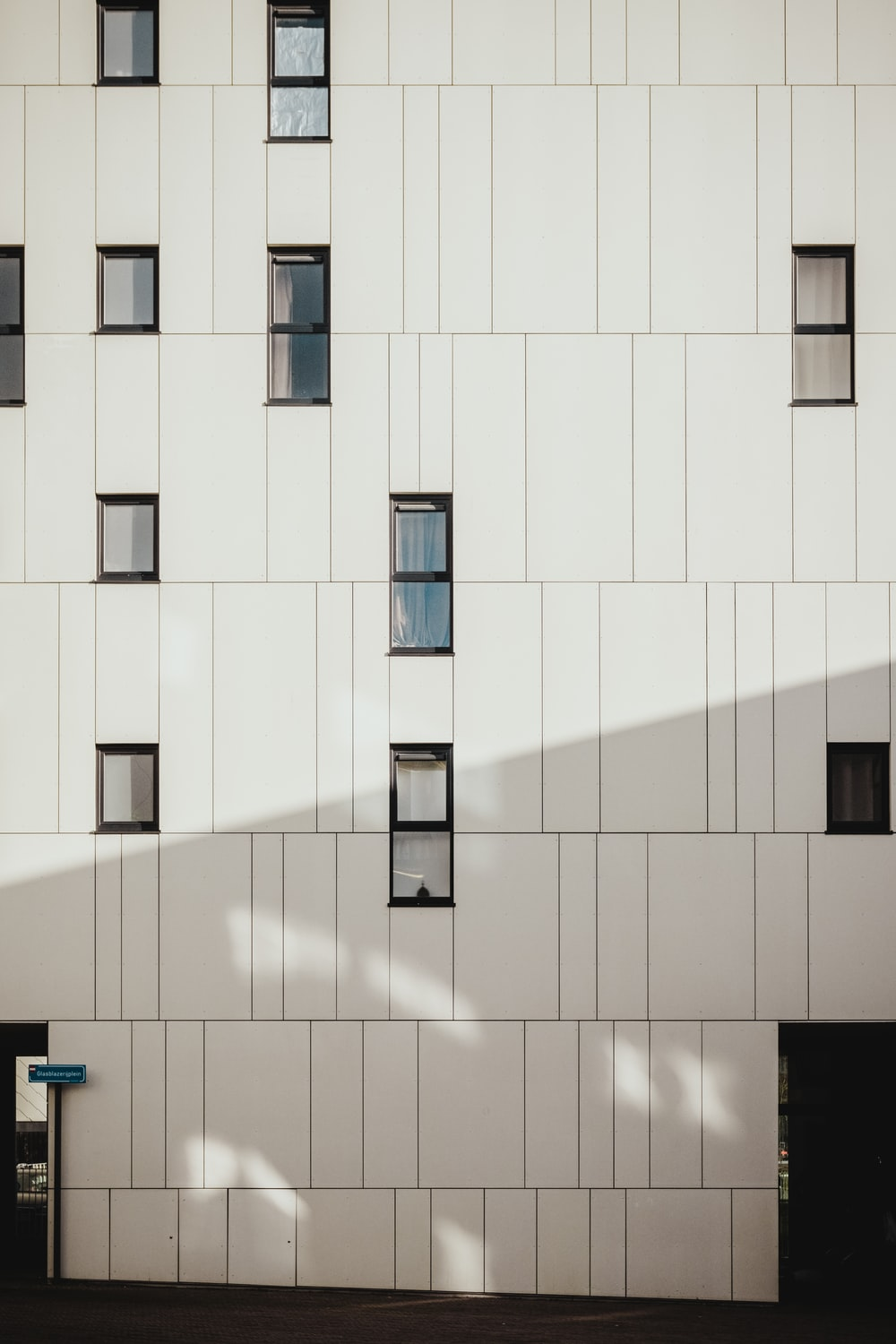 photo of white concrete building during daytime