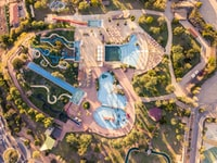 aerial view of park with swimming pools