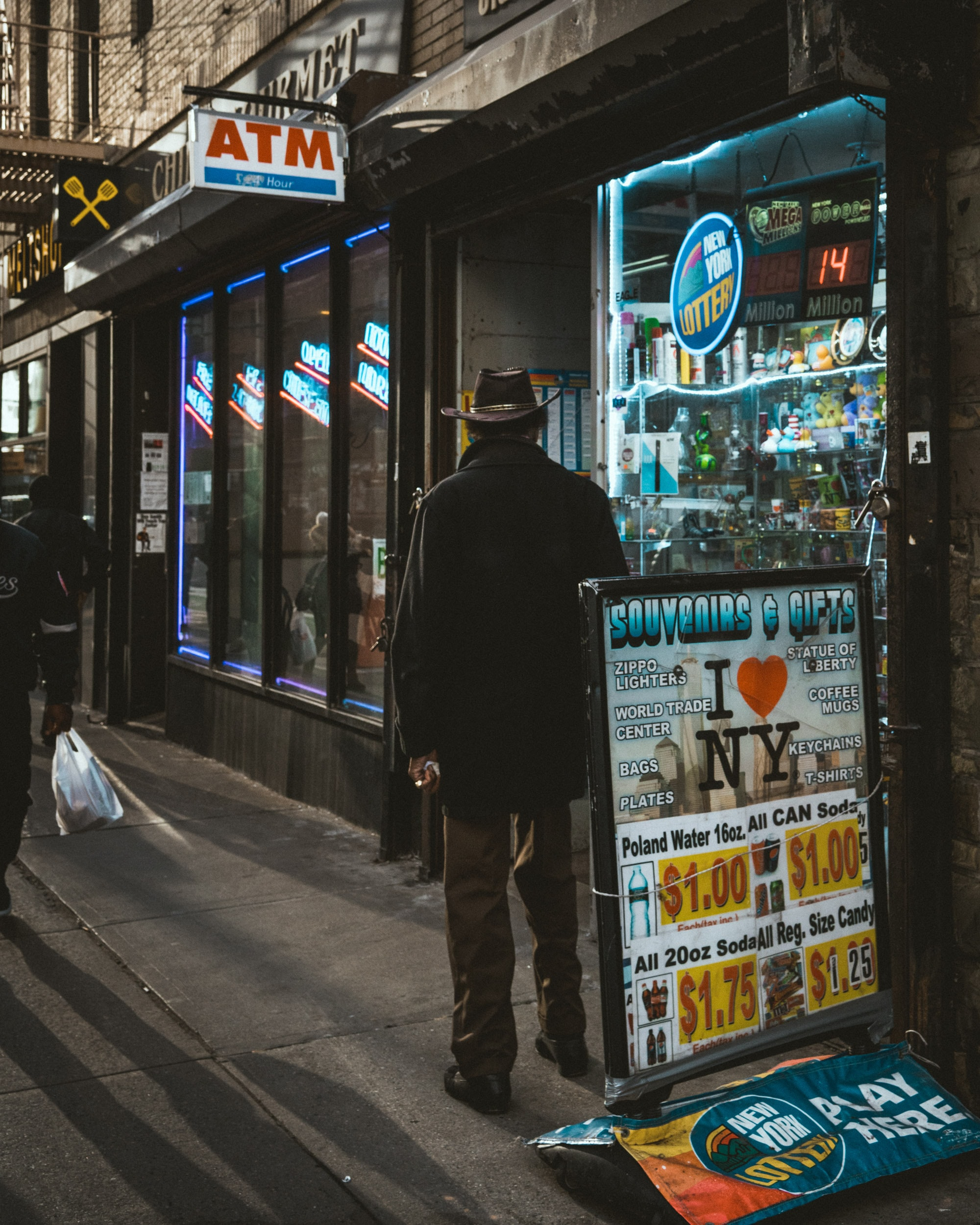 man standing near boutique