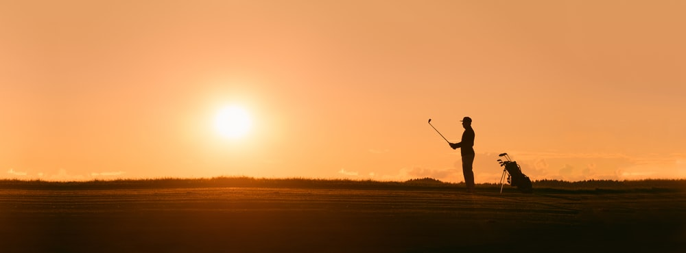 person holding golf club