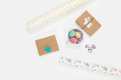 flat lay photography of wallpaper and box wrapping paper teams background