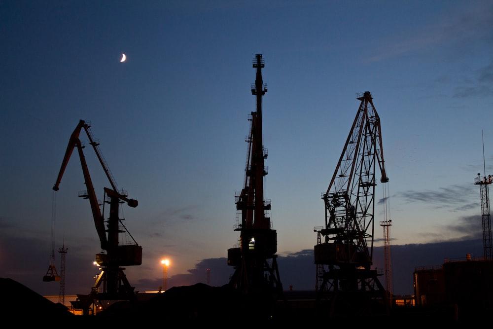 silhouette of metal cranes