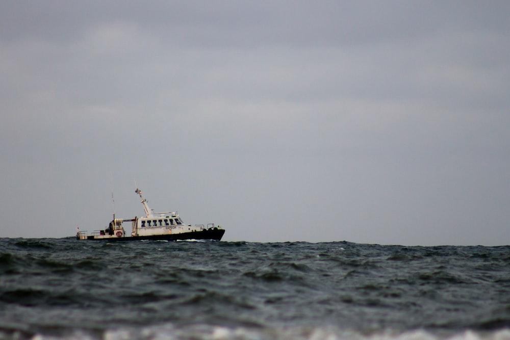 white fishing boat on sea