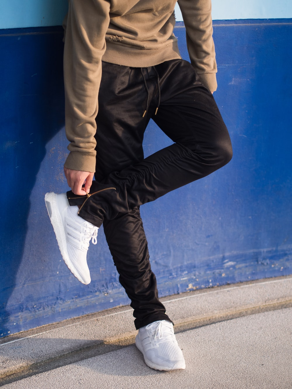 person holding pants zipper