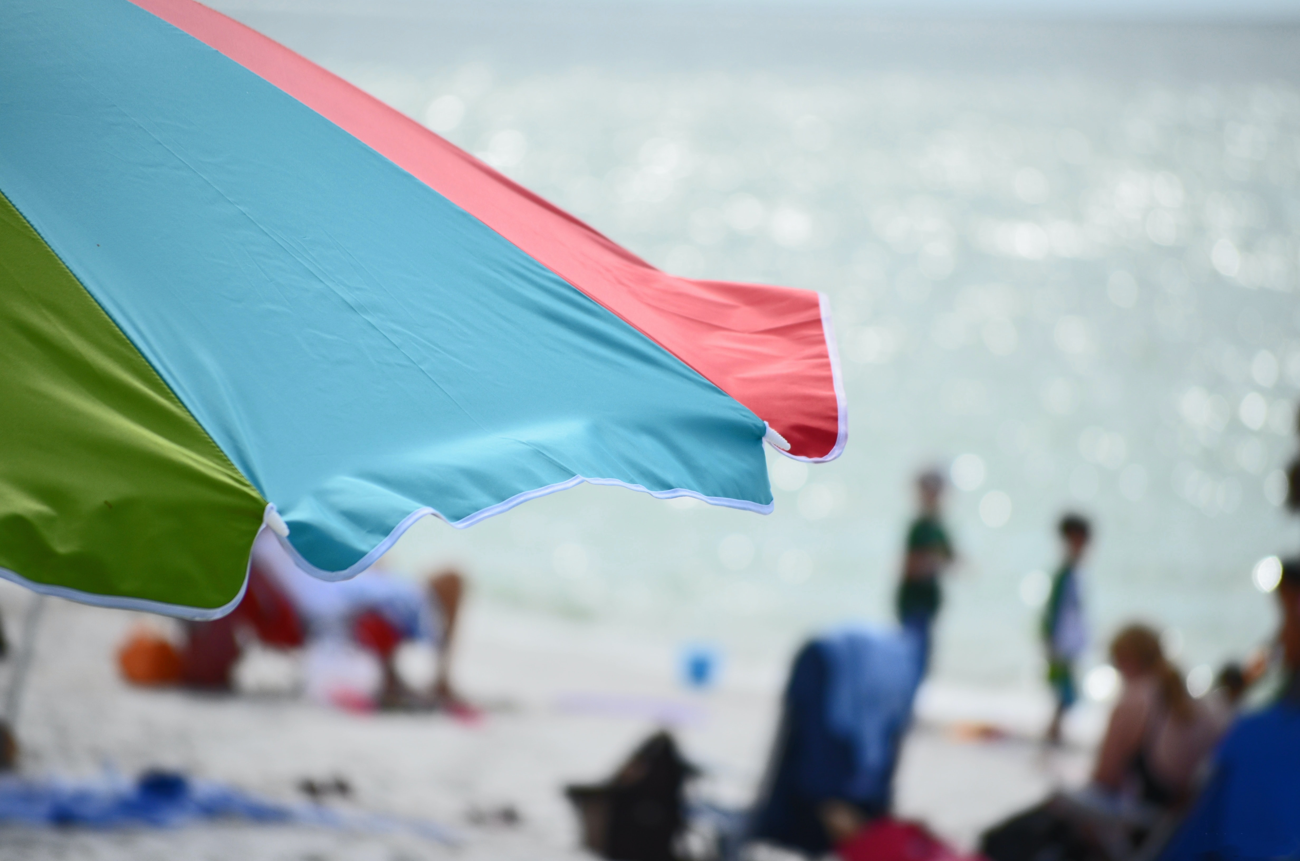 blue, red, and green beach umbrella in closeup shot